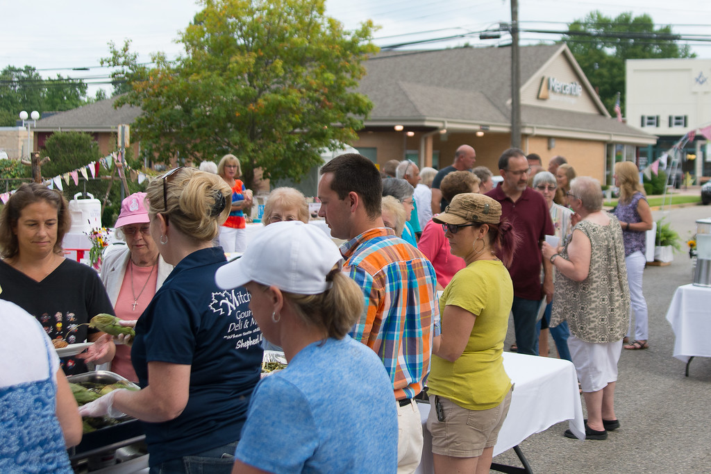 . Megan Elizabeth Photography- Community members met to enjoy a feast of local foods in support of the St. Vincent De Paul Food Pantry.