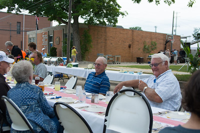 Megan Elizabeth Photography- Community members met to enjoy a feast of local foods in support of the St. Vincent De Paul Food Pantry.