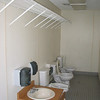 Kid sized restroom fixtures and wire shelving