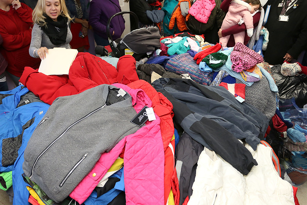 . Worcester County Sheriff Lewis G. Evangelidis was at the Spanish American Center in Leominster on Monday to drop off over 1,000 winter coats. Leominster\'s Warmer Winters hand made hats and gloves for the sheriff to add to his coats to give out at the center as well. A pile of some of the coats. SENTIENL & ENTERPRISE/JOHN LOVE