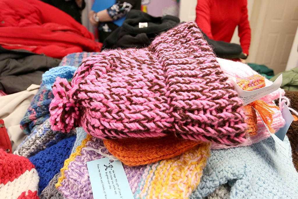 . Worcester County Sheriff Lewis G. Evangelidis was at the Spanish American Center in Leominster on Monday to drop off over 1,000 winter coats. Leominster\'s Warmer Winters hand made hats and gloves for the sheriff to add to his coats to give out at the center as well. One of the hats made by Warmer Winters. SENTIENL & ENTERPRISE/JOHN LOVE