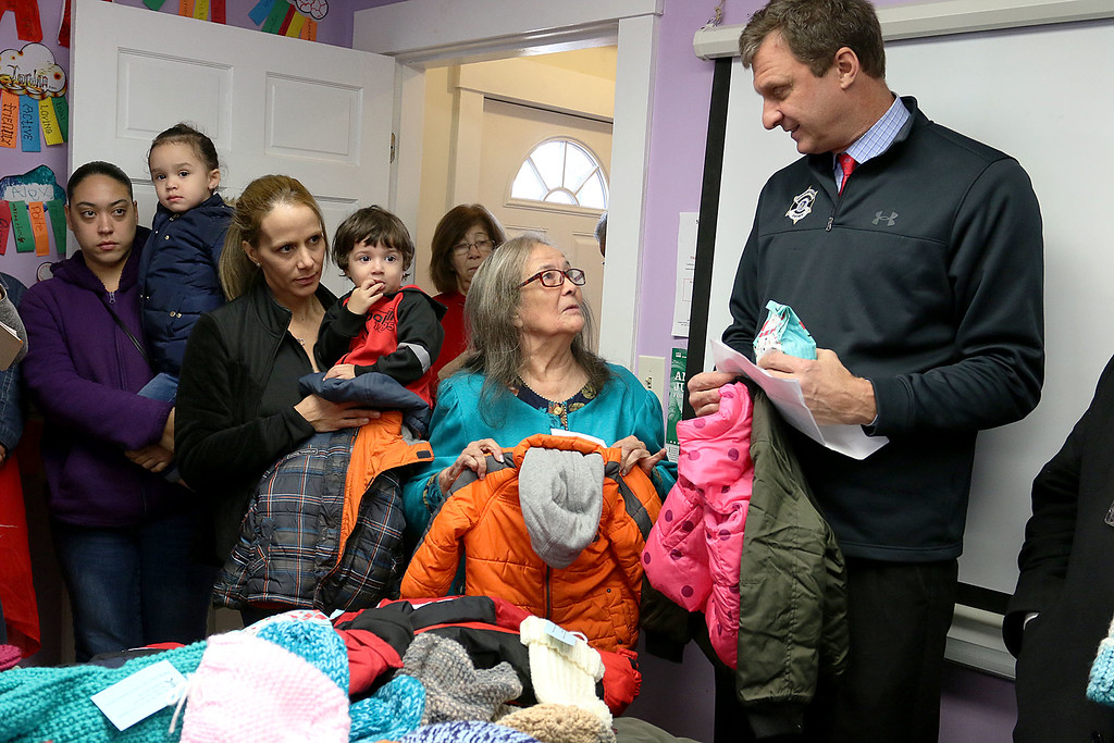 . Worcester County Sheriff Lewis G. Evangelidis was at the Spanish American Center in Leominster on Monday to drop off over 1,000 winter coats. Leominster\'s Warmer Winters hand made hats and gloves for the sheriff to add to his coats to give out at the center as well. SMC\'s Executive Direcotr Neddy Latimer thanks Sheriff Evangelidis for his Help every year. SENTIENL & ENTERPRISE/JOHN LOVE
