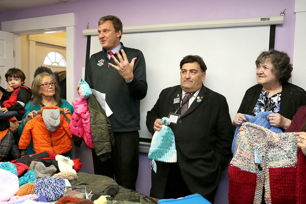 . Worcester County Sheriff Lewis G. Evangelidis was at the Spanish American Center in Leominster on Monday to drop off over 1,000 winter coats. Leominster\'s Warmer Winters hand made hats and gloves for the sheriff to add to his coats to give out at the center as well. Sheriff Evangelidis talks about the coats just after he dropped them off Monday. With him from left is Neddy Latimer the Centers Executive Director, David Roth the Board President for Warmer Winters and the Founder and CEO of Warmer Winters Judy Gentry. SENTIENL & ENTERPRISE/JOHN LOVE