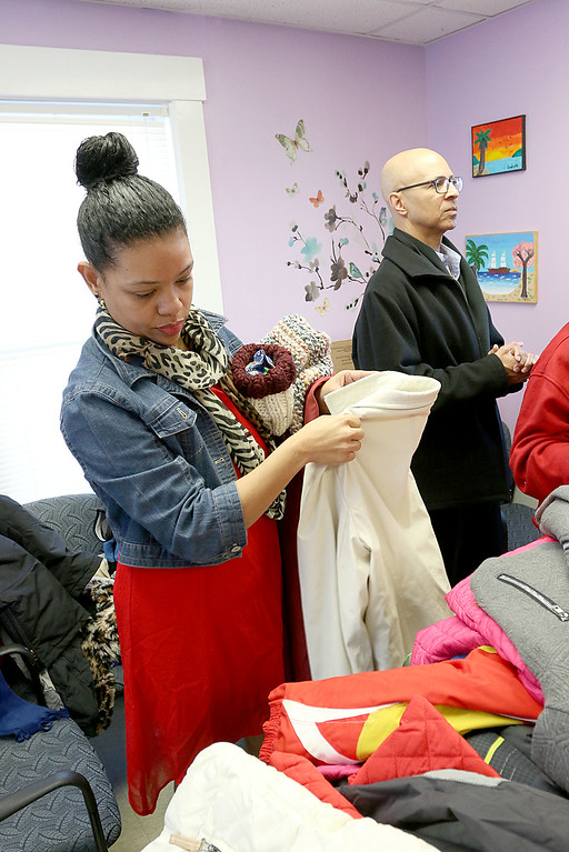 . Worcester County Sheriff Lewis G. Evangelidis was at the Spanish American Center in Leominster on Monday to drop off over 1,000 winter coats. Leominster\'s Warmer Winters hand made hats and gloves for the sheriff to add to his coats to give out at the center as well. Marie Gonzalez tries to pick out a coat at the Center. SENTIENL & ENTERPRISE/JOHN LOVE