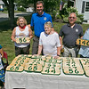 Sheriff Lew Evangelidis & Worcester County Sheriffs Office (WCSO) Community Outreach Team distributed and hang custom design wooden house numbers as part of the WCSO House Numbering Program for Seniors on Thursday in Leominster. All house numbers were made by the Worcester County Sheriff's Office and provided free to all seniors who submit a request form. Sheriff Evangelidis visited Dale Avenue on Thursday in Leominster to give out the numbers. From left with Evangelidis, in blue, is John, 5, and Mali Williams, 10, Doris Gallant, Faith Anderson, Joe D'Ambra with the WCSO's Community Outreach Division and Claire Fontaine. SENTINEL & ENTERPRISE/JOHN LOVE