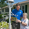 Sheriff Lew Evangelidis & Worcester County Sheriffs Office (WCSO) Community Outreach Team distributed and hang custom design wooden house numbers as part of the WCSO House Numbering Program for Seniors on Thursday in Leominster. All house numbers were made by the Worcester County Sheriff's Office and provided free to all seniors who submit a request form. Sheriff Evangelidis visited Dale Avenue on Thursday in Leominster to give out the numbers. Doris Gallant hangs her new number with Sheriff Evangelidis at her home in Leominster. SENTINEL & ENTERPRISE/JOHN LOVE