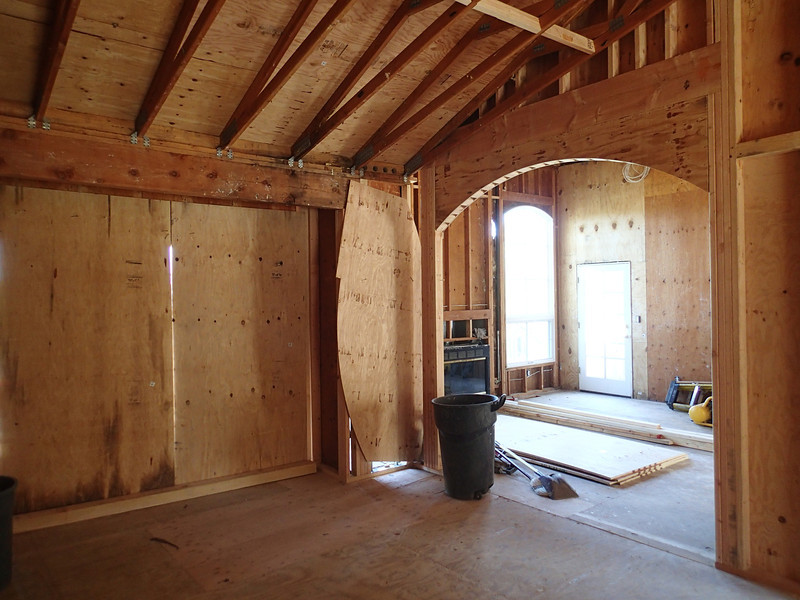 The arch is in between the dining room & living room.