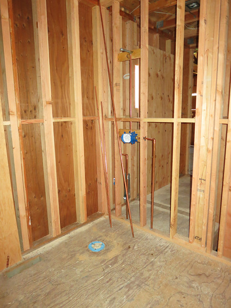 Shower drain in the guest bedroom.