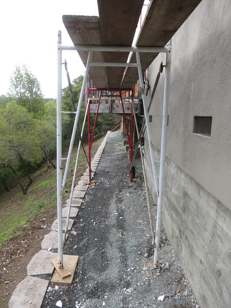 Under the scaffolding..so much for the purty walkway!