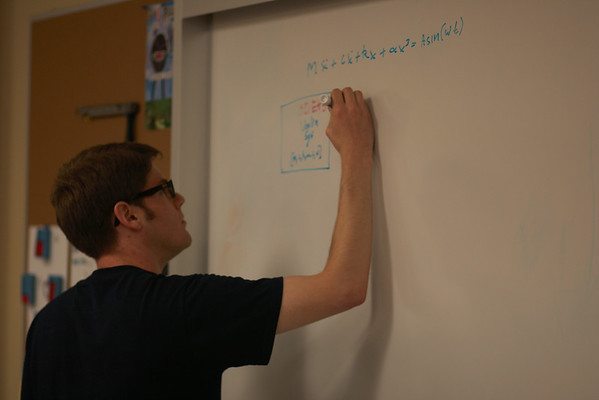 Mike working on solving non-linear dynamics equations for Dr. Doughty's research.