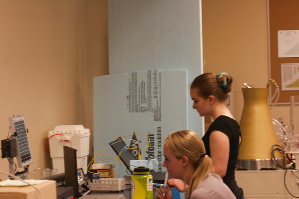 Hollis Crowder and Lydia Gingerich calibrate thermocouples for temperature measurement in Shiley 104.