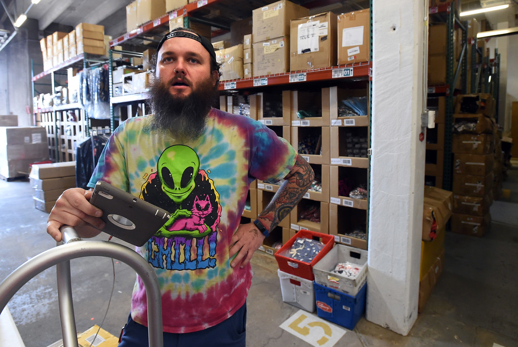 """. Travis Lindsey, who works in the warehouse, is the \""""Rave Cave Fulfillment Director.\"""" Shinesty in Boulder have fun with their job titles. \""""Creative\"""" job titles in Boulder County is on the rise, say job coaches and HR professionals. Cliff Grassmick  Photographer  May 11,  2018"""