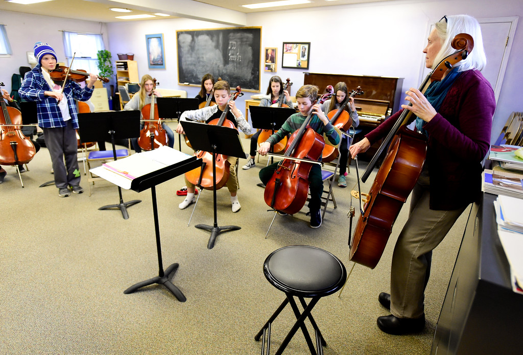 . Orchestra Teacher Kathleen Starr leads a sixth grade class during a warm up exercise at Shining Mountain Waldorf School in Boulder, Colorado on Jan. 8, 2018.  (Photo by Matthew Jonas/Staff Photographer)