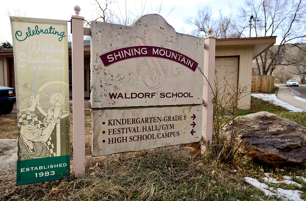 . A building and sign on property owned by Shining Mountain Waldorf School is seen at Broadway and Violet Avenue in Boulder, Colorado on Jan. 8, 2018.  (Photo by Matthew Jonas/Staff Photographer)