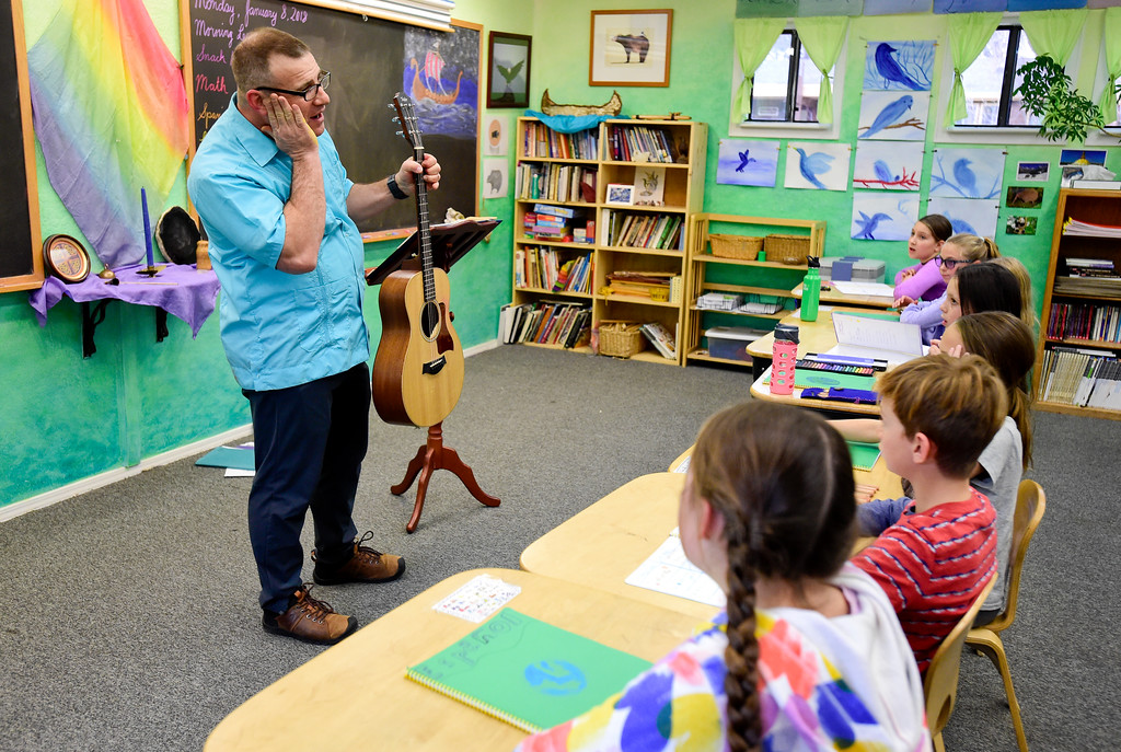. Spanish Teacher Don Josué Berman leads a fourth grade class in a sing along at Shining Mountain Waldorf School in Boulder, Colorado on Jan. 8, 2018.  (Photo by Matthew Jonas/Staff Photographer)