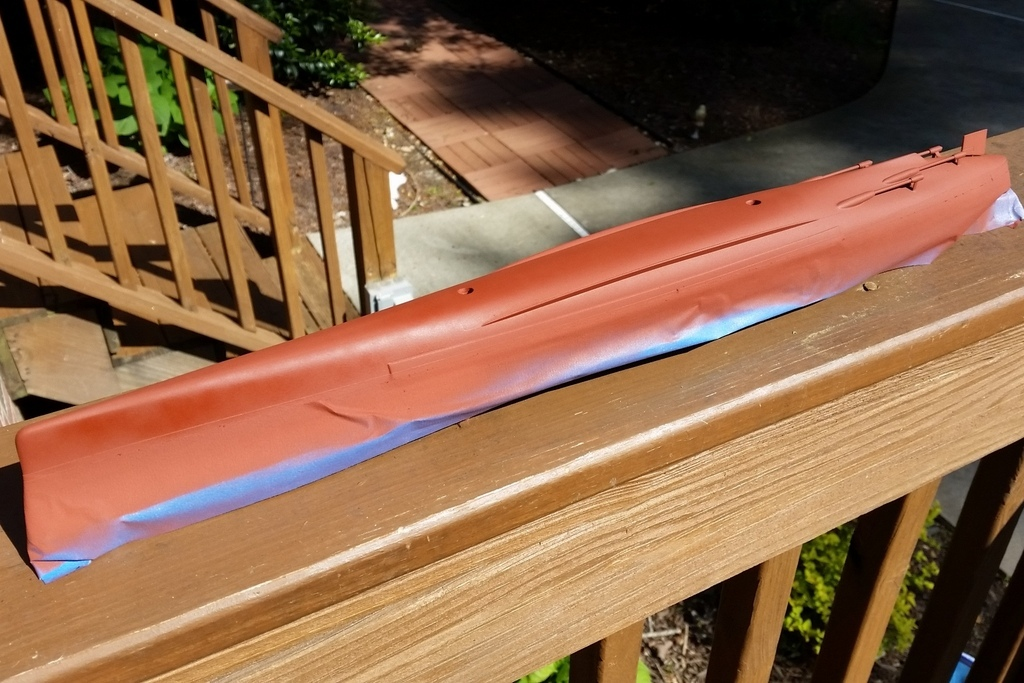 160416: CA-38 Masking the Hull bottom.  Red is rattlecan red-brown primer.