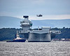 Merlin Mk2 helicopter from 820 Naval Air Squadron passes over the HMS Queen Elizabeth (R08) at Rosyth - 26 June 2017