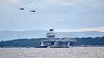 Merlins from 820 Naval Air Squadron passes over the  HMS Queen Elizabeth (R08) at Rosyth - 26 June 2017