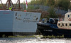 'Defender' Escorted by 'Ayton Cross' to Fitting Out Basin