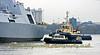HMS Diamond with Tugs Assisting
