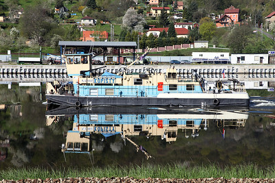 Barge pusher tug KOPISTY is perfectly mirrored in the still waters of the Labe at Strekov, Czech Republic. Thursday 21st April 2016.