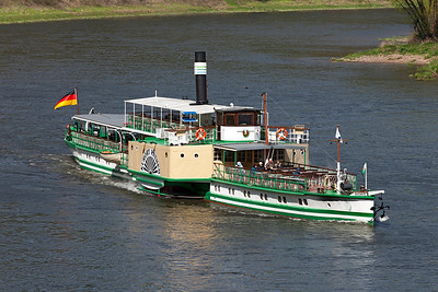 1896 built Steam Paddle Steamer 'Kurort Rathen' heads along the River Elbe passing Konigstein on a cruise from Dresden. Wednesday 20th April 2016.