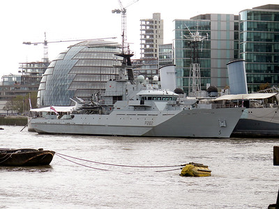 Royal Navy Offshore Patrol Vessel HMS SEVERN P282 moored alongside HMS BELFAST in the River Thames. Saturday 8th November 2014.