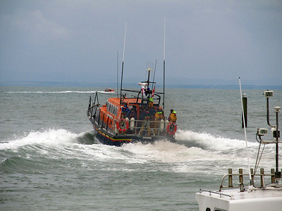 Ilfracombe's Mersey Class Lifeboat 12-007 'Spirit of Derbyshire' powers away from Lynmouth Harbour. Saturday 9th August 2014.