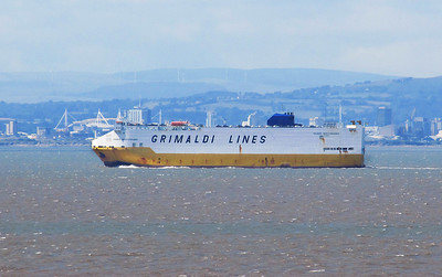 With the city of Cardiff in the background GRANDE MEDITERRANEO heads down the Bristol Channel with cars from Portbury to Cork. 30th July 2013.