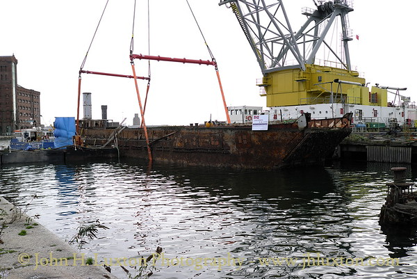 Raising LCT 7074 from the East Float, Birkenhead Docks on October 18, 2014