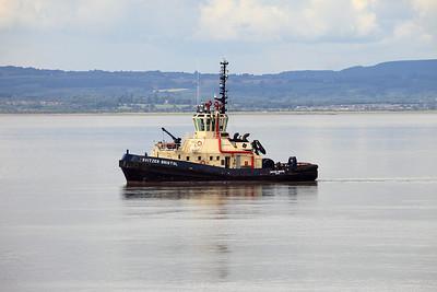 SVITZER BRISTOL heads down a flat calm Severn Estuary on its way to meet the inbound MSC MARIA. 22nd July 2010.