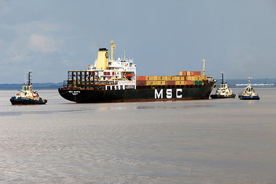 MSC MARIA approaches Portbury Dock from Antwerp to discharge and load containers with attendant tugs SVITZER BRISTOL, SVITZER BRUNEL & SVITZER SKY. Thursday 22nd July 2010.