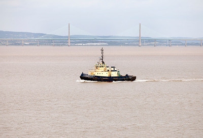With the Second Severn Crossing in the background tug SVITZER BEVOIS heads down river from Portbury to meet an incoming vessel. 6th July 2010.