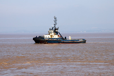 Tug PORTGARTH heads out to meet EMERALD LEADER. Sunday 18th May 2014.