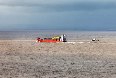 ALIDA departs Portbury for Dunkirque as tug TRITON heads for Swansea. Friday 21st February 2014.