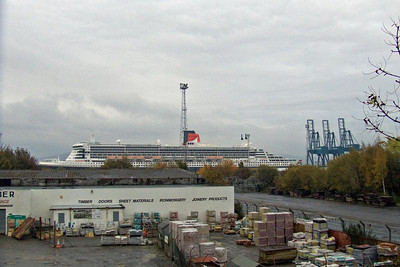 Looking over the former railway sidings for the Ocean Terminal from Union Street with the Queen Mary 2 towering over the Ocean Termial. The sidings are on the location of the former Princes Pier Station shed