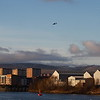 A Loganair de Havilland Canada DHC-6-310 Twin Otter about to cross the River Clyde as it approaches Glasgow Airport. Taken from the Clyde walkway in Renfrew. In the background is Yoker and Yoker Ferry.