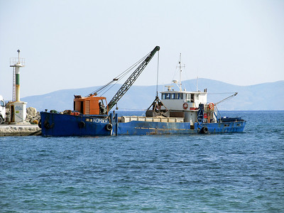 NOMIKH unloads stone at Mastihari Harbour, Kos having arrived from Kalymnos. Tuesday 27th May 2014.