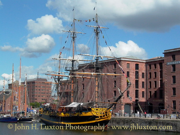 Replica Royal Navy 6th Rate frigate GRAND TURK seen in Canning Half Tide Basin beside the Merseyside Maritime Museum on June 12, 2003. She was visiting for the Mersey River Festival. The ship will be remembered for featuring as HMS INDEFATIGABLE in the Hornblower Television series.