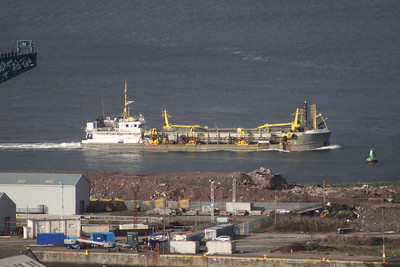 The dredger Sospan-Dau passing the James Watt Dock