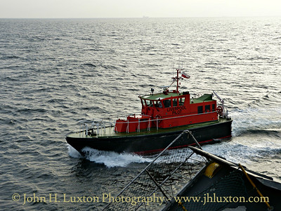 PV KITTIWAKE delivers the pilot to MANANNAN - September 20, 2014