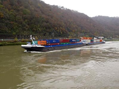 Barge MONTANA, MMSI 244690697 plus unpowered barge MONTANA II heading upstream near Sankt Goar. Thursday 20th November 2014.