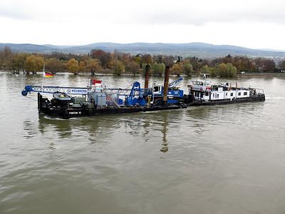 Barge Tug SAXONIA, MMSI 211502880 pushes a dreging barge down stream near Oestrich-Winkel. Wednesday 19th November 2014.