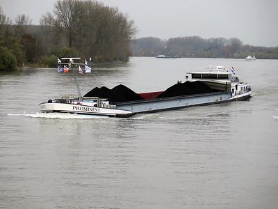 Barge PROMINENT, MMSI 244700109 has a cargo of coal heading up stream near Gernsheim. Wednesday 19th November 2014.