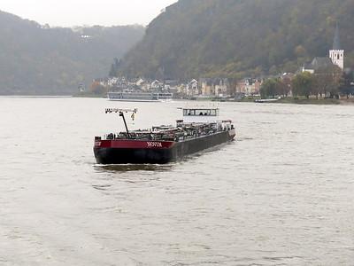 Tanker NOVUM, MMSI 244670589, exits the Loreley narrows passing Sankt Goar downstream. Thursday 20th November 2014.
