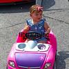 Car Show, New Roads, LA, 3-13-2021.  Street scene little girl in car stroller.