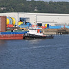 Work boats, barges and cement tankers for new Forth road bridge construction works - tug Kraft alongside barge
