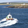 Kirkwall Pilot boat John Rae heading back to Kirkwall after picking up pilot from Boudicca.  Helliar Holm Lighthouse, Balfour Castle and Shapinsay island in background