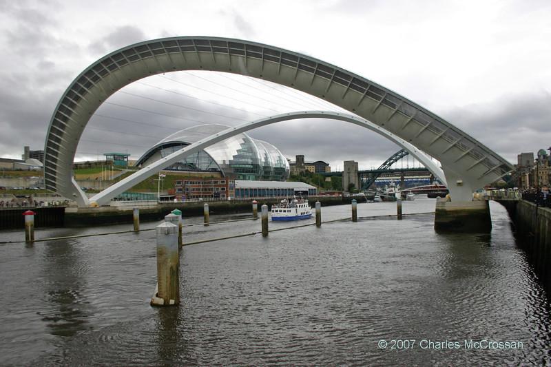 Fortuna passing under open Millenium Bridge