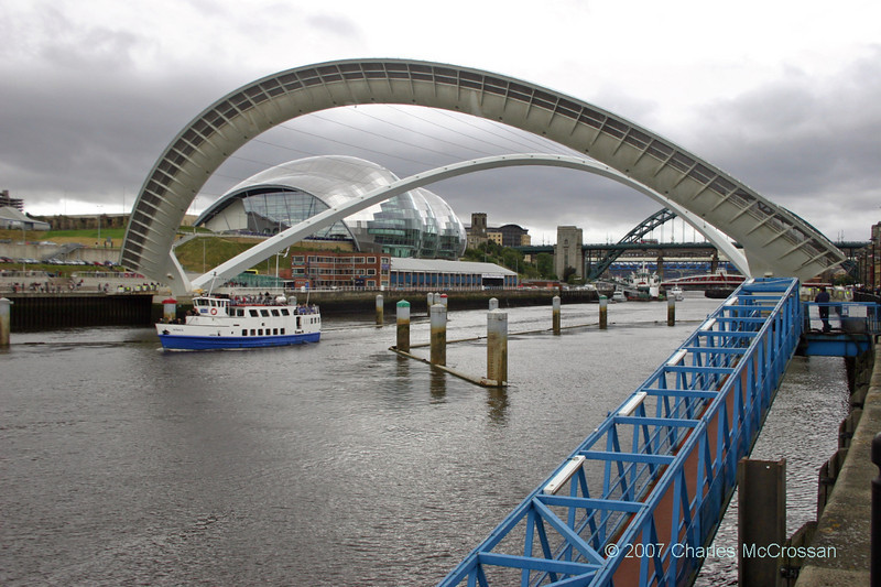 Fortuna passing under open Millenium Bridge